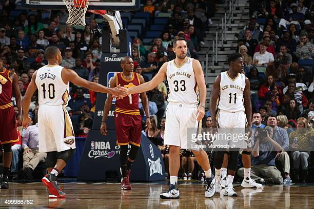 Ryan Anderson of the New Orleans Pelicans is high fived by teammate Eric Gordon of the New Orleans Pelicans during the game against the Cleveland...