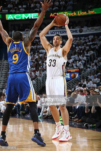 Ryan Anderson of the New Orleans Pelicans looks to move the ball against Andre Iguodala of the Golden State Warriors during Game Four of the Western...