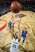 Ryan Anderson of the New Orleans Pelicans reaches for the rebound against the Dallas Mavericks during an NBA game on November 10 2015 at the Smoothie...