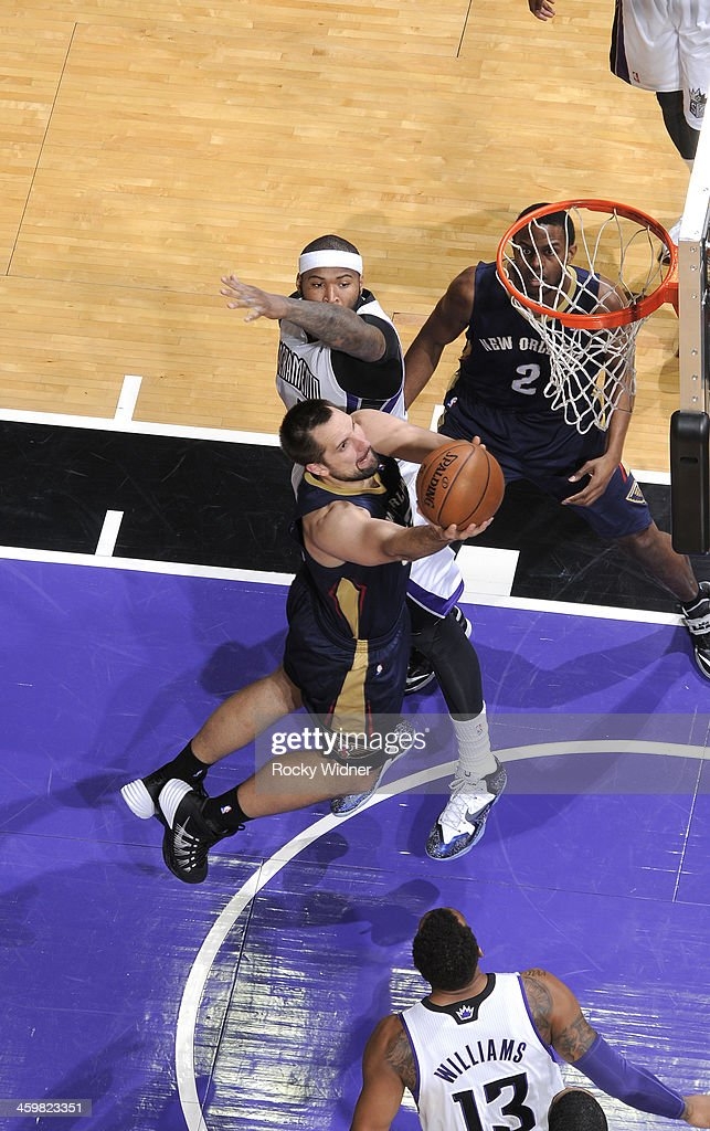 Ryan Anderson #33 of the New Orleans Pelicans shoot a layup against <a gi-track='captionPersonalityLinkClicked' href=/galleries/search?phrase=DeMarcus+Cousins&family=editorial&specificpeople=5792008 ng-click='$event.stopPropagation()'>DeMarcus Cousins</a> #15 of the Sacramento Kings on December 23, 2013 at Sleep Train Arena in Sacramento, California.