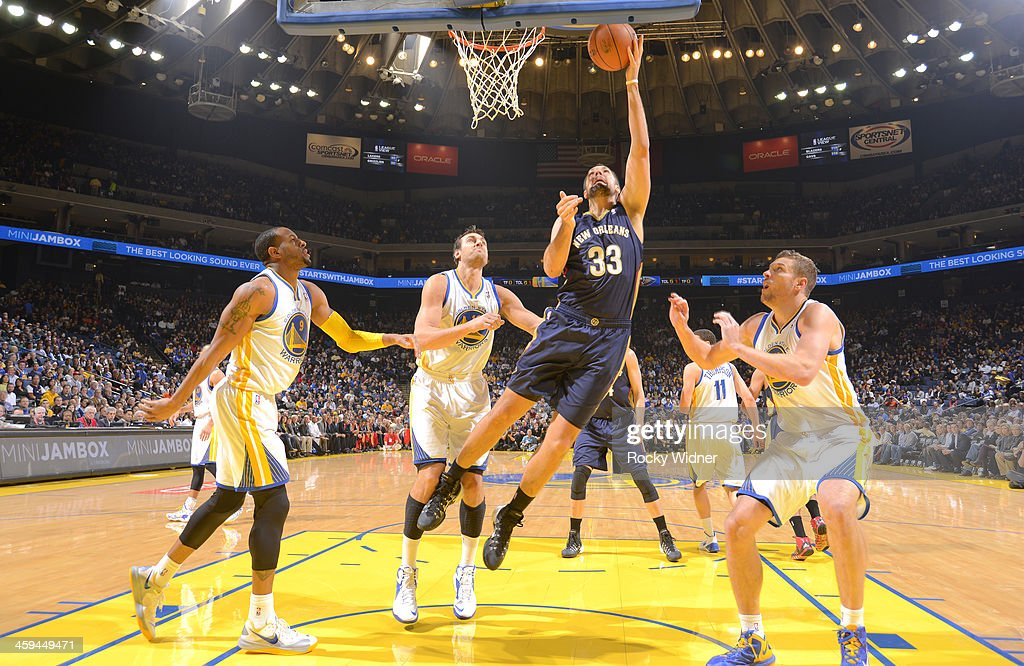 Ryan Anderson #33 of the New Orleans Pelicans shoots against <a gi-track='captionPersonalityLinkClicked' href=/galleries/search?phrase=Andre+Iguodala&family=editorial&specificpeople=201980 ng-click='$event.stopPropagation()'>Andre Iguodala</a> #9, <a gi-track='captionPersonalityLinkClicked' href=/galleries/search?phrase=Andrew+Bogut&family=editorial&specificpeople=207105 ng-click='$event.stopPropagation()'>Andrew Bogut</a> #12, and David Lee #10 of the Golden State Warriors on December 17, 2013 at Oracle Arena in Oakland, California.