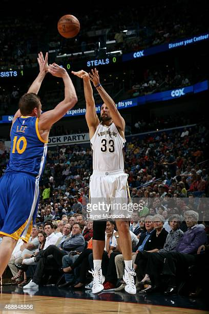Ryan Anderson of the New Orleans Pelicans shoots against the Golden State Warriors on April 7 2015 at Smoothie King Center in New Orleans Louisiana...