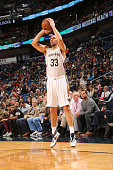 Ryan Anderson of the New Orleans Pelicans shoots against the Houston Rockets on January 25 2016 at the Smoothie King Center in New Orleans Louisiana...
