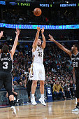 Ryan Anderson of the New Orleans Pelicans shoots against the San Antonio Spurs on December 26 2014 at Smoothie King Center in New Orleans Louisiana...