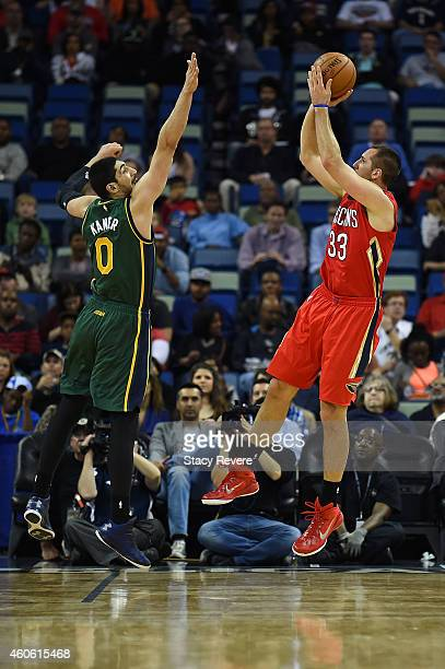 Ryan Anderson of the New Orleans Pelicans shoots over Enes Kanter of the Utah Jazz during the first half of a game at the Smoothie King Center on...