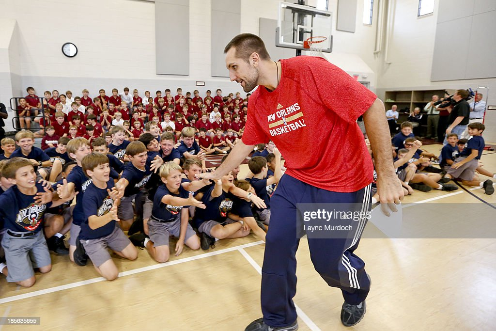 Ryan Anderson of the New Orleans Pelicans slaps hands with students as the team partnered with Ochsner Health System, Blue Cross Blue Shield of Louisiana and the Louisiana Campaign for Tobacco-Free Living (TFL) celebrate the launch of the Pelicans Junior Training Camp program on October 21, 2013 at Christian Brothers School in New Orleans, Louisiana.