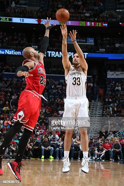 Ryan Anderson of the New Orleans Pelicans takes a shot against the Chicago Bulls on February 7 2015 at Smoothie King Center in New Orleans Louisiana...