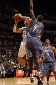 Ryan Anderson of the Orlando Magic goes up for a shot against DeSagana Diop of the Charlotte Bobcats during the game at Time Warner Cable Arena on...