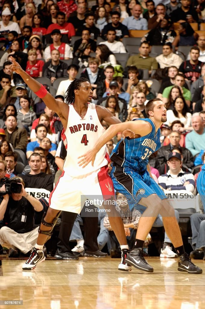 Ryan Anderson of the Orlando Magic guards Chris Bosh of the Toronto Raptors during the game on November 1 2009 at Air Canada Centre in Toronto Canada...