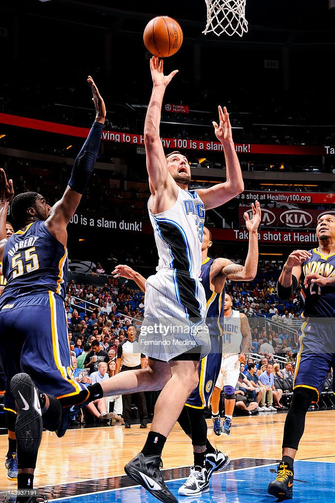 Ryan Anderson #33 of the Orlando Magic shoots against <a gi-track='captionPersonalityLinkClicked' href=/galleries/search?phrase=Roy+Hibbert&family=editorial&specificpeople=725128 ng-click='$event.stopPropagation()'>Roy Hibbert</a> #55 of the Indiana Pacers in Game Four of the Eastern Conference Quarterfinals during the 2012 NBA Playoffs on May 5, 2012 at Amway Center in Orlando, Florida.
