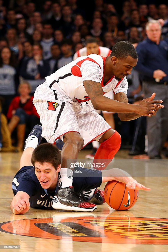 Ryan Arcidiacono (L) #15 of the Villanova Wildcats attempts to steal the ball from in the first half Russ Smith #2 of the Louisville Cardinals during the quaterfinals of the Big East Men's Basketball Tournament at Madison Square Garden on March 14, 2013 in New York City.