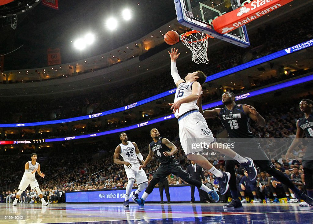 <a gi-track='captionPersonalityLinkClicked' href=/galleries/search?phrase=Ryan+Arcidiacono&family=editorial&specificpeople=7887112 ng-click='$event.stopPropagation()'>Ryan Arcidiacono</a> #15 of the Villanova Wildcats attempts a layup as <a gi-track='captionPersonalityLinkClicked' href=/galleries/search?phrase=D%27Vauntes+Smith-Rivera&family=editorial&specificpeople=9966427 ng-click='$event.stopPropagation()'>D'Vauntes Smith-Rivera</a> #4, Jessie Govan #15 and L.J. Peak #0 of the Georgetown Hoyas defend during the first half of an NCAA college basketball game on March 5, 2016 at the Wells Fargo Center in Philadelphia, Pennsylvania.