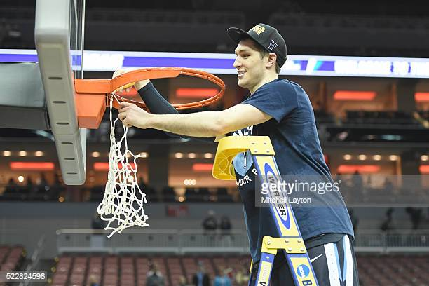 Ryan Arcidiacono of the Villanova Wildcats cuts down the net after winning the quarterfinal of the 2016 NCAA Men's Basketball Tournament game against...