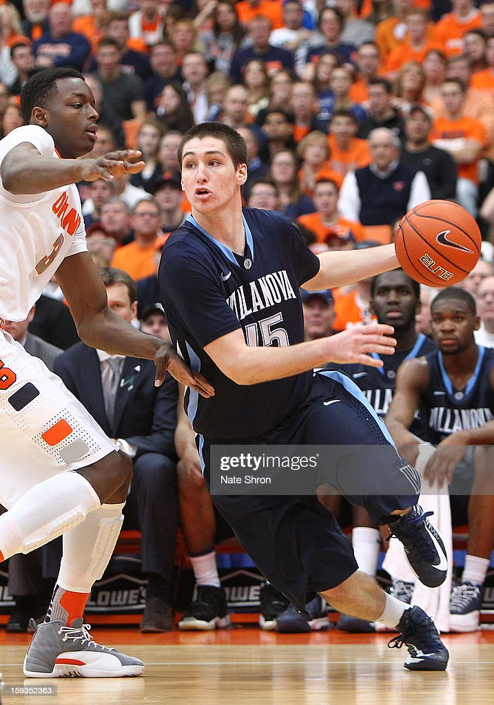 Ryan Arcidiacono #15 of the Villanova Wildcats drives to the basket against Jerami Grant #3 of the Syracuse Orange during the game at the Carrier Dome on January 12, 2013 in Syracuse, New York.