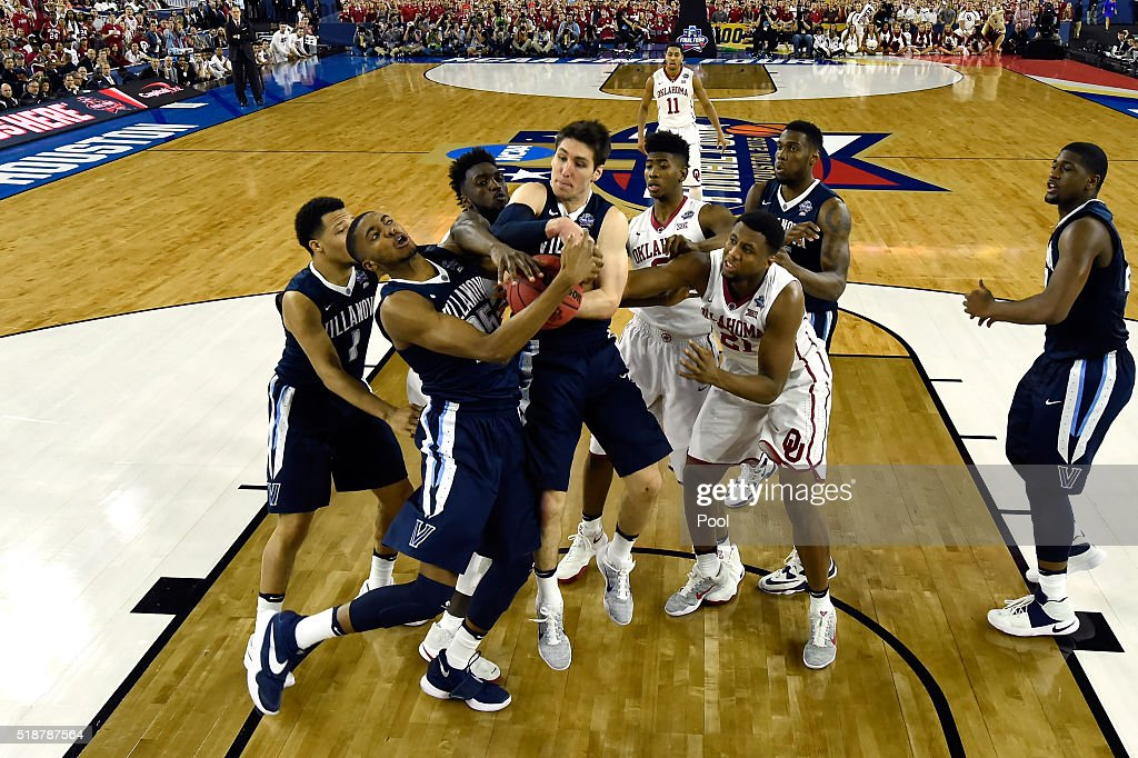 Ryan Arcidiacono of the Villanova Wildcats rebounds the ball against the Oklahoma Sooners during the NCAA Men's Final Four Semifinal at NRG Stadium...