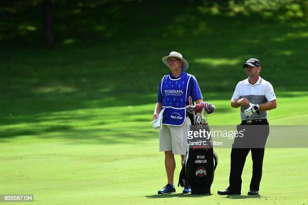 Ryan Armour and his caddie look on from the sixth fairway during the third round of the Wyndham Championship at Sedgefield Country Club on August 19...