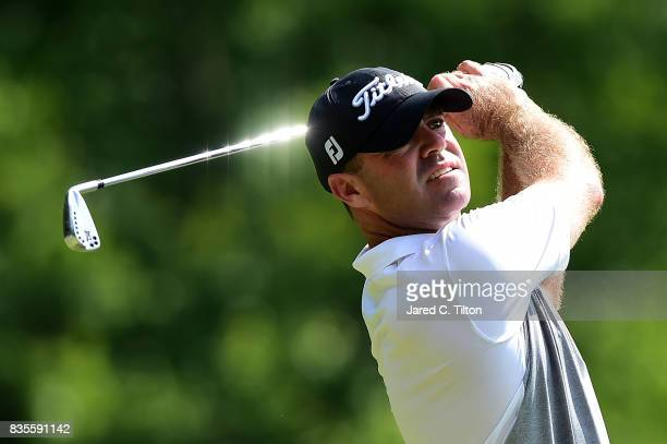 Ryan Armour plays his tee shot on the seventh hole during the third round of the Wyndham Championship at Sedgefield Country Club on August 19 2017 in...