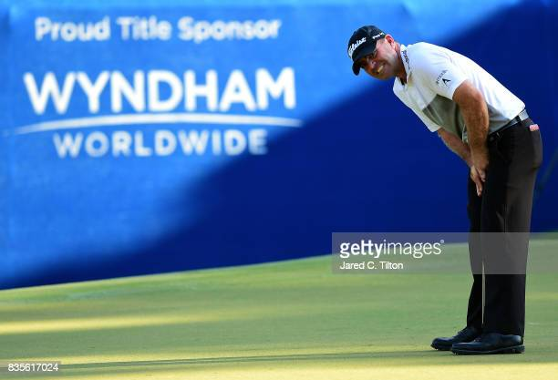 Ryan Armour reacts after missing his birdie putt on the 18th green during the third round of the Wyndham Championship at Sedgefield Country Club on...