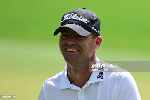 Ryan Armour walks off the green after making his eagle putt on the fifth hole during the third round of the Wyndham Championship at Sedgefield...