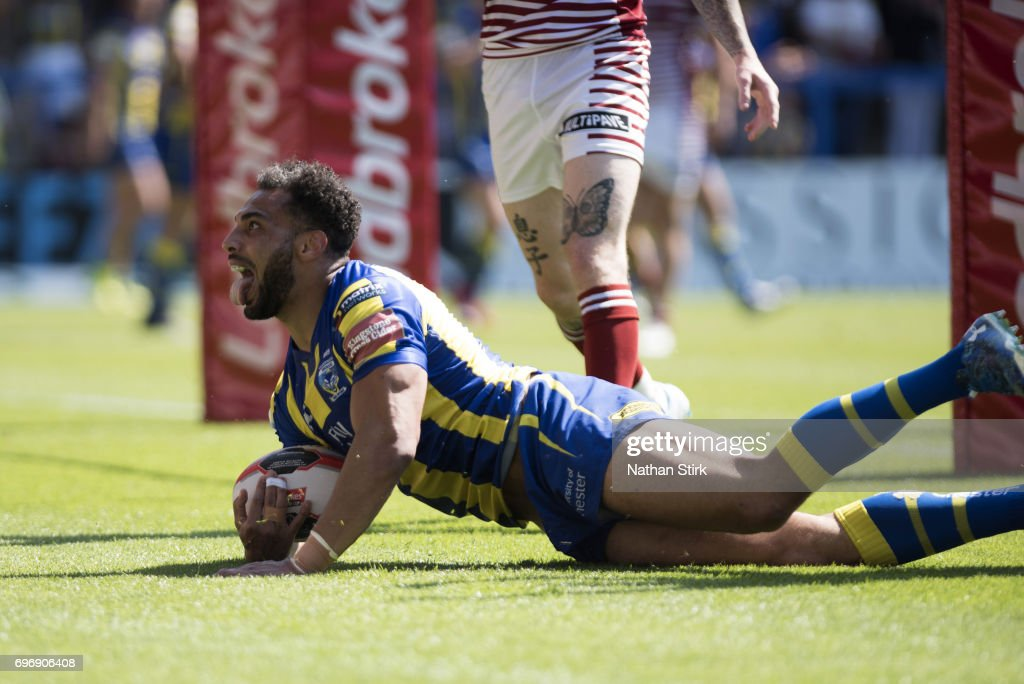 Ryan Atkins of Warrington Wolves scores a try during the Ladbrokes Challenge Cup Quarter-Final match between Warrington Wolves and Wigan Warriors at Halliwell Jones Stadium on June 17, 2017 in Warrington, England.