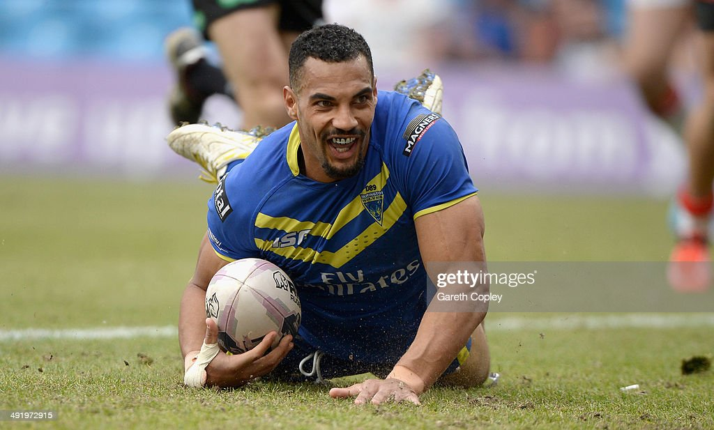 Ryan Atkins of Warrington Wolves scores his team's 5th try during the Super League match between Warrington Wolves and St Helens at Etihad Stadium on May 18, 2014 in Manchester, England.