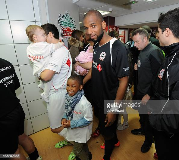 Ryan Babel and his son before the Liverpool All Star Charity Match at Anfield on March 29 2015 in Liverpool England
