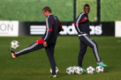Ryan Babel and Siem De Jong warm up during the Ajax Amsterdam training session at De Toekomst training ground on October 2 2012 in Amsterdam...