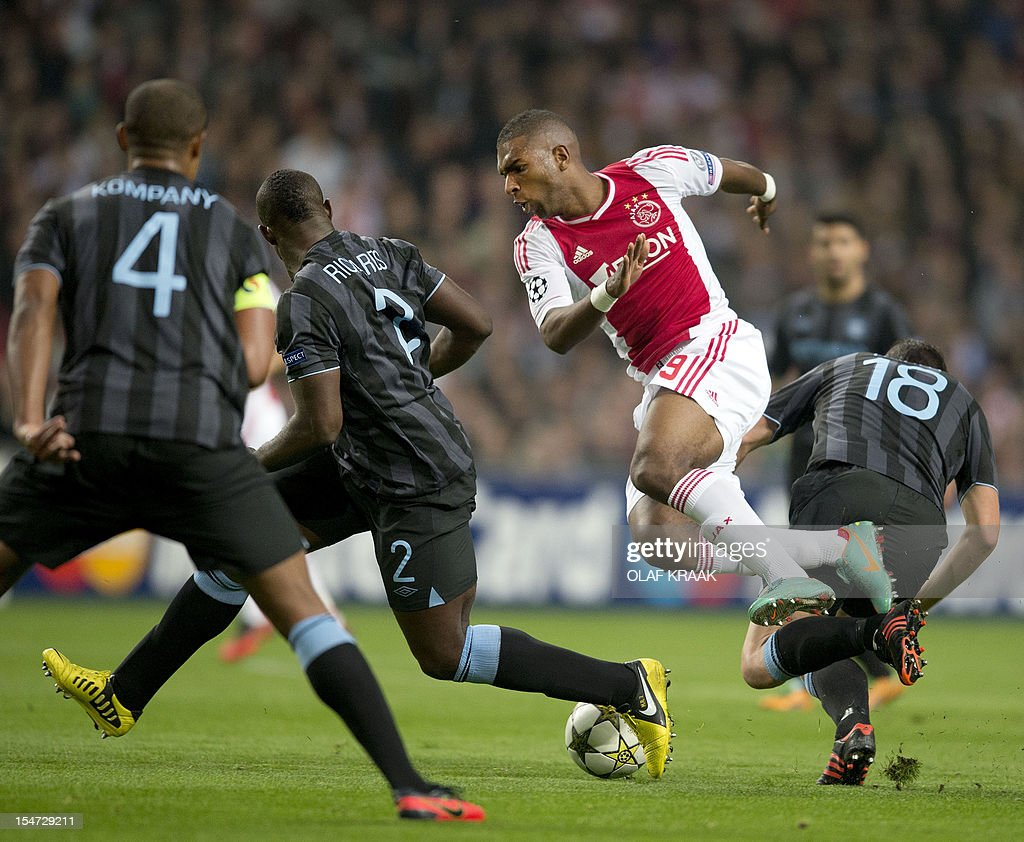 Ryan Babel (2nd R) of Ajax Amsterdam duels with Micha Richards (M) and Gareth Barry (R) of Manchester City during the UEFA Champions League Group D football match against Ajax and Manchester City at Amsterdam ArenA in Amsterdam on October 24, 2012. Ajax won the game 3-1. AFP PHOTO / ANP - OLAF KRAAK - Netherlands out