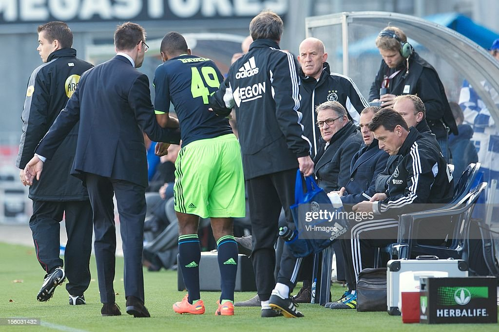 Ryan Babel of Ajax, assistant trainer Dennis Bergkamp of Ajax, assistant trainer Hennie Spijkerman of Ajax during the Dutch Eredivisie match between PEC Zwolle and Ajax Amsterdam at the IJsseldelta Stadium on November 11, 2012 in Zwolle, The Netherlands.