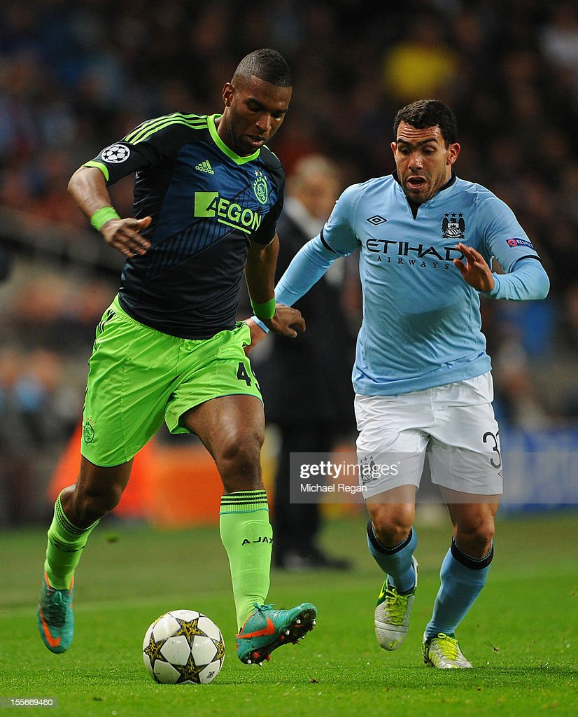 Ryan Babel of Ajax competes with Carlos Tevez of Manchester City during the UEFA Champions League Group D match between Manchester City FC and Ajax Amsterdam at the Etihad Stadium on November 6, 2012 in Manchester, England.
