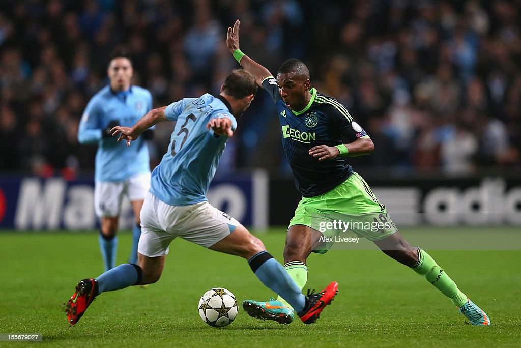 Ryan Babel of Ajax competes with Pablo Zabaleta of Manchester City during the UEFA Champions League Group D match between Manchester City FC and Ajax Amsterdam at the Etihad Stadium on November 6, 2012 in Manchester, England.