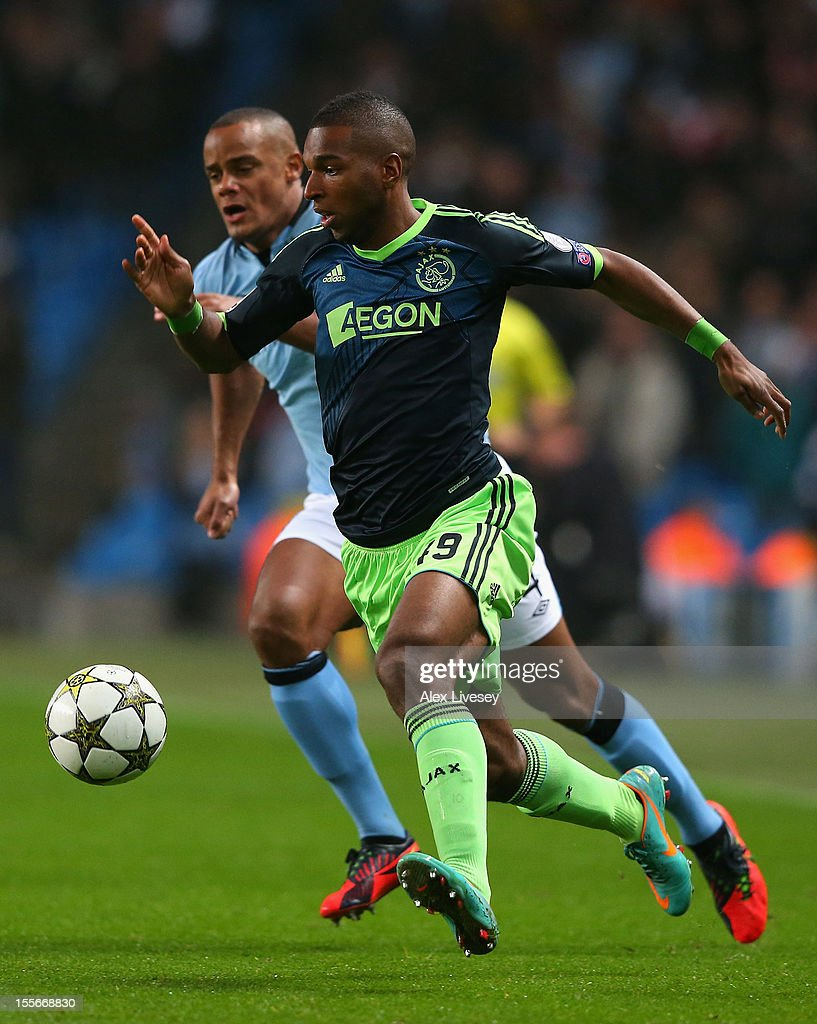 Ryan Babel of Ajax competes with Vincent Kompany of Manchester City during the UEFA Champions League Group D match between Manchester City FC and Ajax Amsterdam at the Etihad Stadium on November 6, 2012 in Manchester, England.