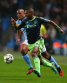 Ryan Babel of Ajax competes with Vincent Kompany of Manchester City during the UEFA Champions League Group D match between Manchester City FC and...