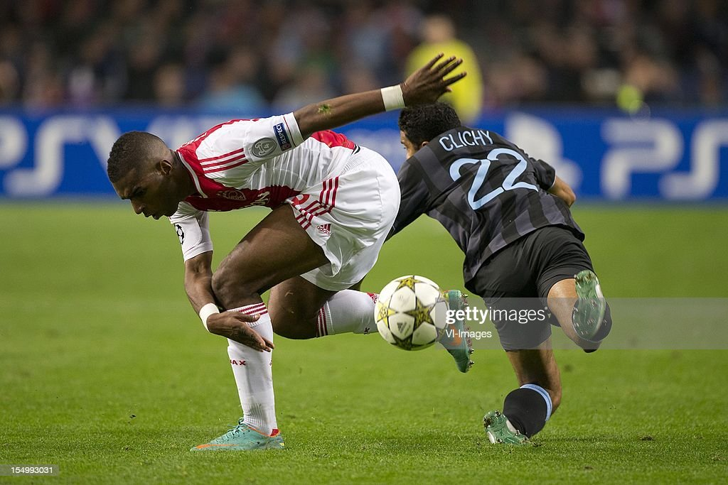 Ryan Babel of Ajax, Gael Clichy of Manchester City during the Champions League match between Ajax Amsterdam and Manchester City at the Amsterdam Arena on October 24, 2012 in Amsterdam, The Netherlands.