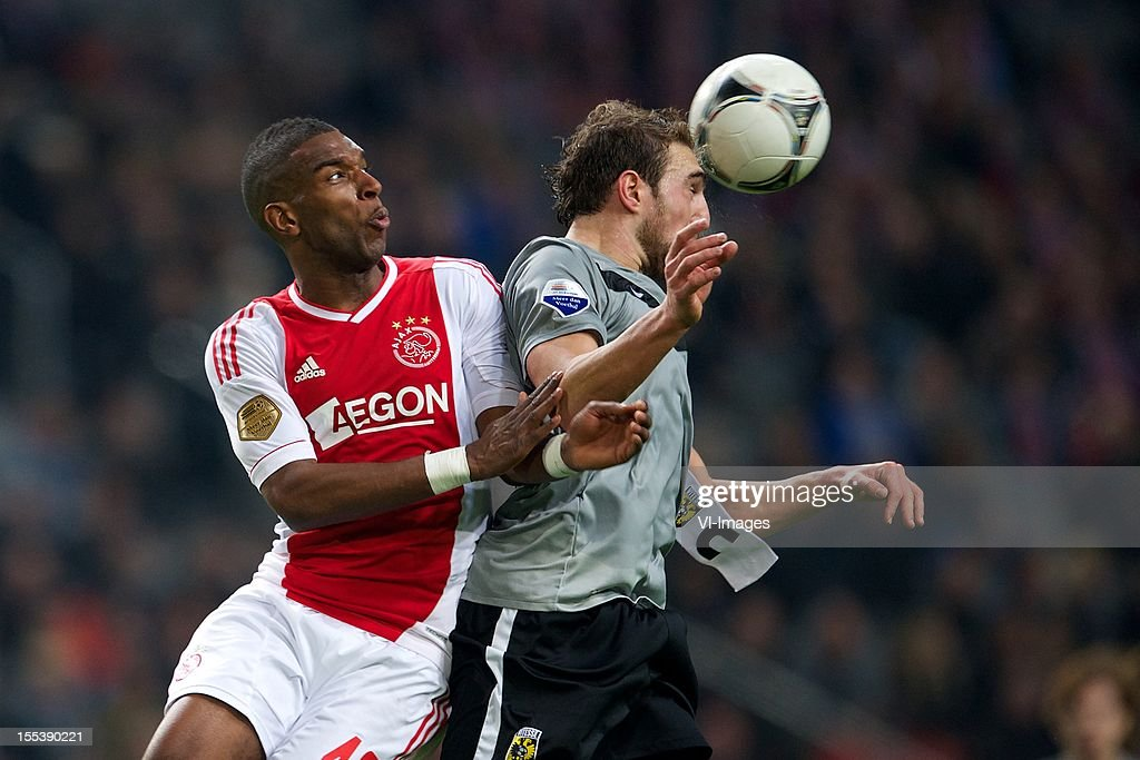 Ryan Babel of Ajax, Guram Kashia of Vitesse during the Dutch Eredivisie match between Ajax Amsterdam and Vitesse Arnhem at the Amsterdam Arena on November 3, 2012 in Amsterdam, The Netherlands.