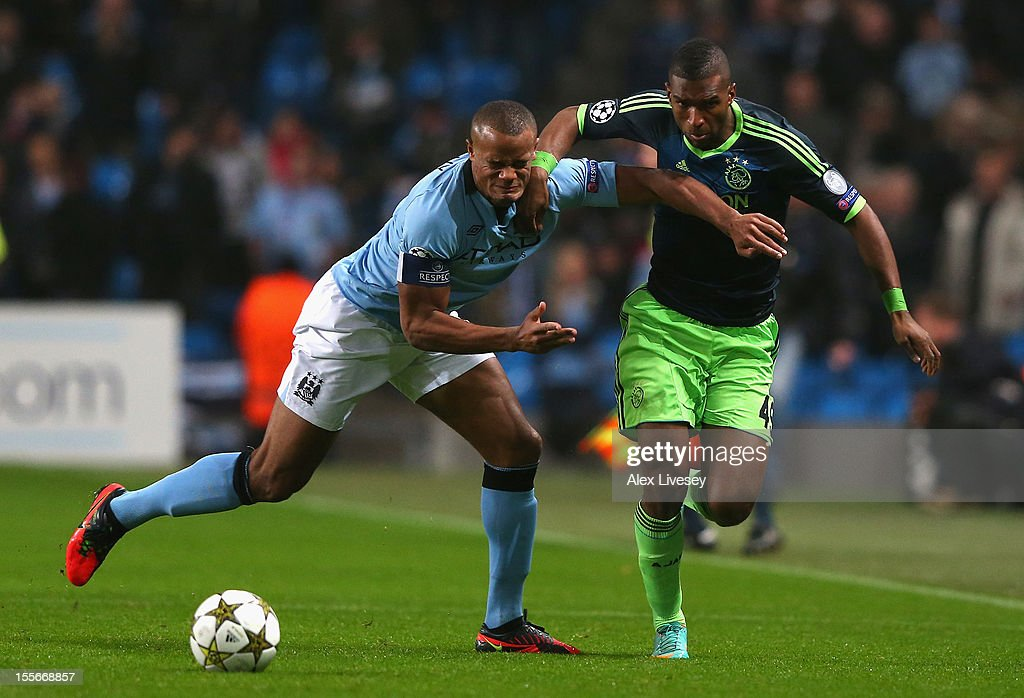 Ryan Babel of Ajax holds off the chalenge of Vincent Kompany of Manchester City during the UEFA Champions League Group D match between Manchester City FC and Ajax Amsterdam at the Etihad Stadium on November 6, 2012 in Manchester, England.