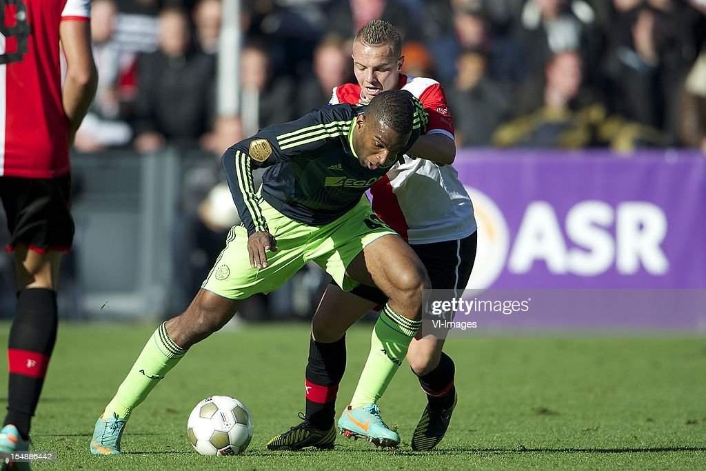Ryan Babel of Ajax, Jordy Clasie of Feyenoord during the Dutch Eredivisie match between Feyenoord and Ajax Amsterdam at De Kuip on October 28, 2012 in Rotterdam, The Netherlands.