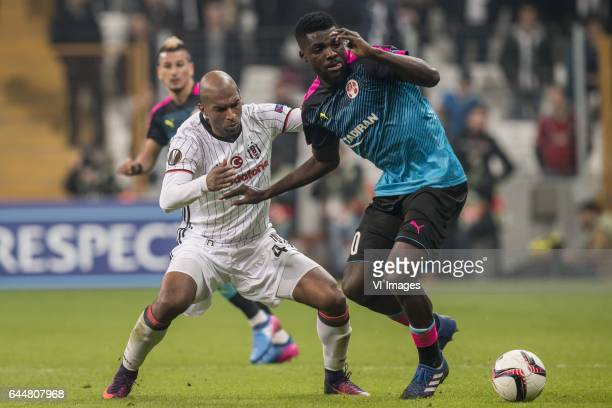 Ryan Babel of Besiktas JK John Ogu of Hapoel Beer Shevaduring the UEFA Europa League round of 16 match between Besiktas JK and Hapoel Beer Sheva on...