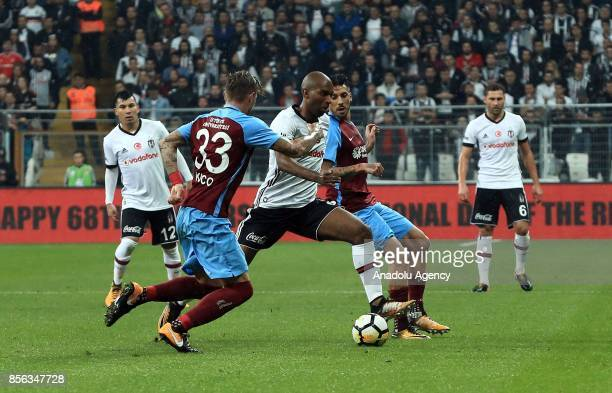 Ryan Babel of Besiktas vies with Juraj Kucka of Trabzonspor during the Turkish Super Lig soccer match between Besiktas and Trabzonspor at Vodafone...