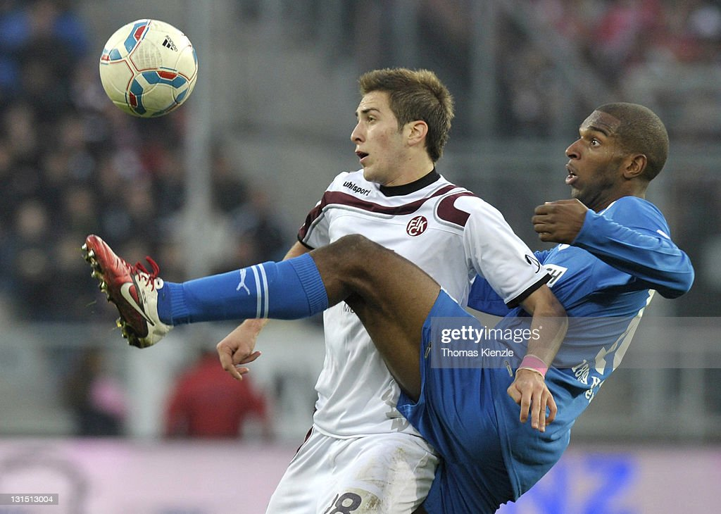 <a gi-track='captionPersonalityLinkClicked' href=/galleries/search?phrase=Ryan+Babel&family=editorial&specificpeople=543539 ng-click='$event.stopPropagation()'>Ryan Babel</a> of Hoffenheim (R) and Konstantinos Fortounis of Kaiserslautern vie for the ball during the Bundesliga match between 1899 Hoffenheim and 1. FC Kaiserslautern at Rhein-Neckar-Arena on November 5, 2011 in Sinsheim, Germany.