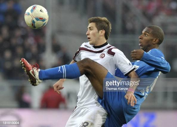 Ryan Babel of Hoffenheim and Konstantinos Fortounis of Kaiserslautern vie for the ball during the Bundesliga match between 1899 Hoffenheim and 1 FC...