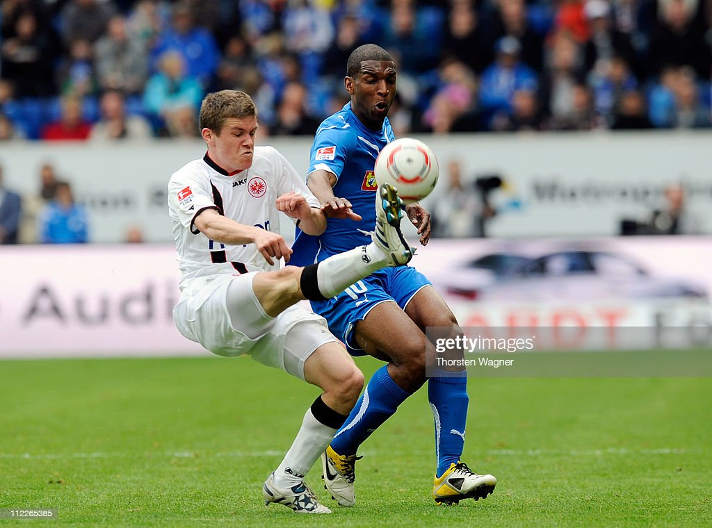 <a gi-track='captionPersonalityLinkClicked' href=/galleries/search?phrase=Ryan+Babel&family=editorial&specificpeople=543539 ng-click='$event.stopPropagation()'>Ryan Babel</a> (R) of Hoffenheim battles for the ball with <a gi-track='captionPersonalityLinkClicked' href=/galleries/search?phrase=Pirmin+Schwegler&family=editorial&specificpeople=604263 ng-click='$event.stopPropagation()'>Pirmin Schwegler</a> (L) of Frankfurt during the Bundesliga match between TSG 1899 Hoffenheim and Eintracht Frankfurt at Rhein-Neckar Arena on April 16, 2011 in Sinsheim, Germany.