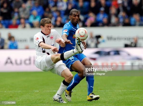 Ryan Babel of Hoffenheim battles for the ball with Pirmin Schwegler of Frankfurt during the Bundesliga match between TSG 1899 Hoffenheim and...