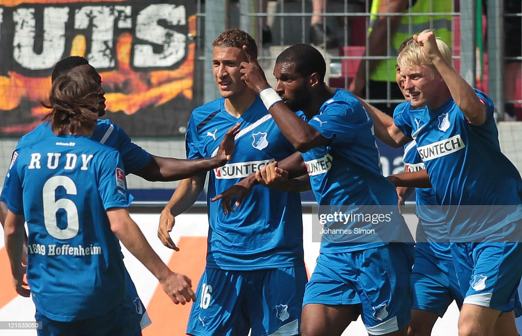 <a gi-track='captionPersonalityLinkClicked' href=/galleries/search?phrase=Ryan+Babel&family=editorial&specificpeople=543539 ng-click='$event.stopPropagation()'>Ryan Babel</a> (2R) of Hoffenheim celebrates with his team mates after scoring his team's first goal during the Bundesliga match between FC Augsburg and 1899 Hoffenheim at SGL Arena on August 20, 2011 in Augsburg, Germany.