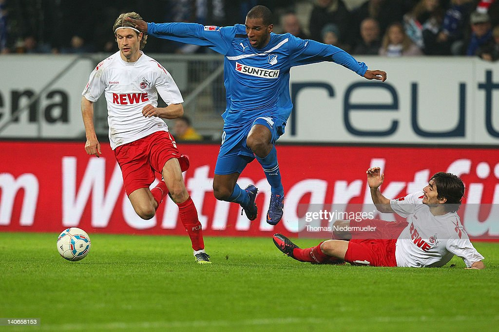 <a gi-track='captionPersonalityLinkClicked' href=/galleries/search?phrase=Ryan+Babel&family=editorial&specificpeople=543539 ng-click='$event.stopPropagation()'>Ryan Babel</a> (C) of Hoffenheim fights for the ball with <a gi-track='captionPersonalityLinkClicked' href=/galleries/search?phrase=Martin+Lanig&family=editorial&specificpeople=750456 ng-click='$event.stopPropagation()'>Martin Lanig</a> (L) and Fonseca Sereno (R) of Koeln during the Bundesliga match between 1899 Hoffenheim and 1. FC Koeln at Rhein-Neckar-Arena on March 4, 2012 in Sinsheim, Germany.