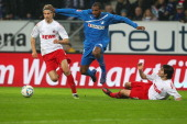 Ryan Babel of Hoffenheim fights for the ball with Martin Lanig and Fonseca Sereno of Koeln during the Bundesliga match between 1899 Hoffenheim and 1...