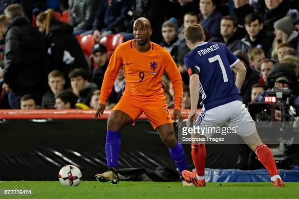 Ryan Babel of Holland James Forrest of Scotland during the International Friendly match between Scotland v Holland at the Pittodrie Stadium on...