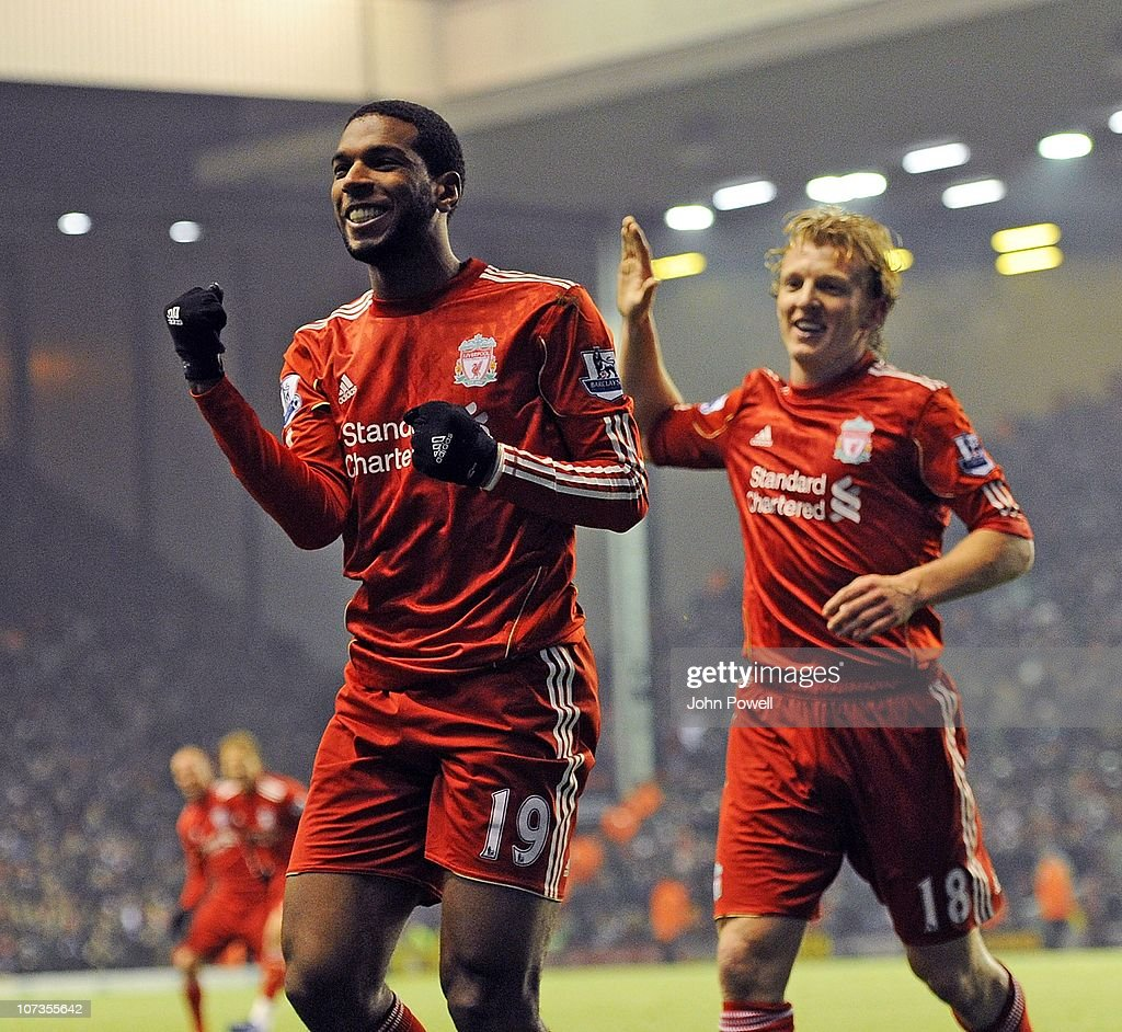 Ryan Babel of Liverpool celebrates with Dirk Kuyt after scoring the second goal during the Barclays Premier League match between Liverpool and Aston...