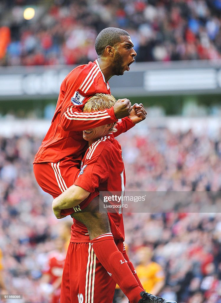 Ryan Babel of Liverpool celebrates with team mate Dirk Kuyt after scoring a goal to make it 51 during the Barclays Premier League match between...