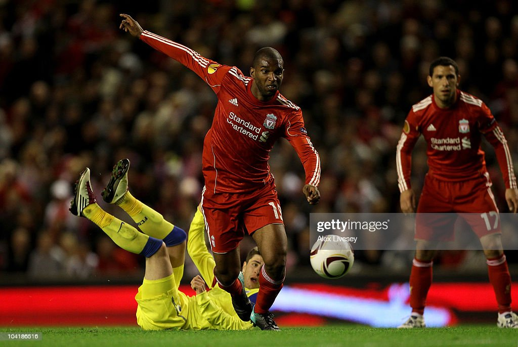 Ryan Babel of Liverpool goes past Mihai Radut of Steaua Bucharest during the UEFA Europa League Group K match beteween Liverpool and Steaua Bucharest...